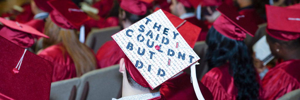 Image is of the top of a student's graduation cap which says,